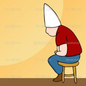 dunce-hat-man-on-stool
